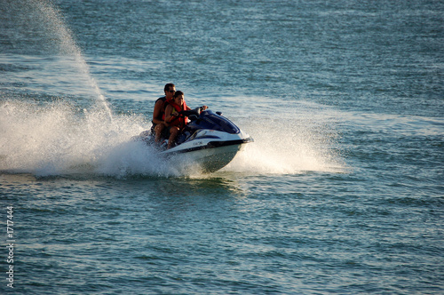 woman and man on a jetski