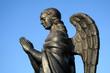 fragment of a bronze sculpture of a praying angel 6