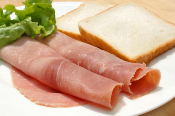 diet meal, rolled ham, salad and toast on plate