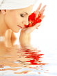 lady with red petals in water