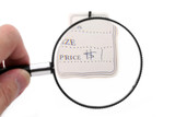 price tag and magnifier poster
