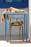 sweet siesta of kitten under kitchen table poster