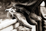 row of rodeo boots & spurs