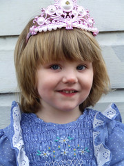 close up of baby in tiara
