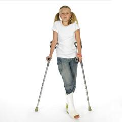 girl with a broken leg walking on crutches