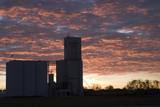 grain elevators against the morning sky poster