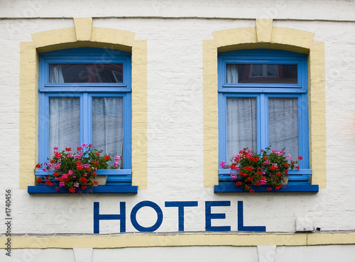 hotel in french town with hotel written on wall