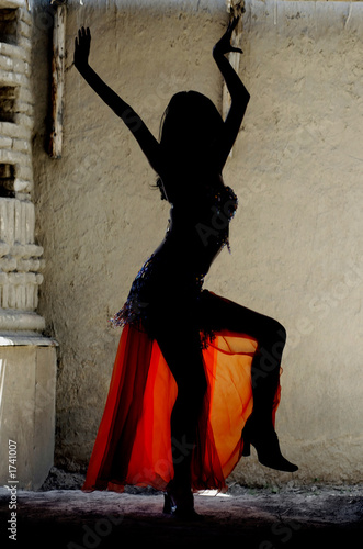woman dancing belly-dance in oriental costume