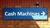sign for cash machines.arrow.wall.bulb