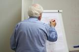 Fototapety professor writes on the blackboard