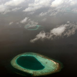 atoll in maldives, view from the plane poster