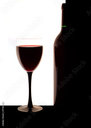 glass with a wine and a bottle.