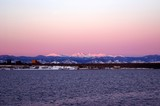 winter sunrise in denver with a lake and mountains poster
