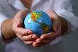 globe on hands