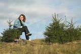 girl in fir trees poster