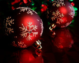 two red snowflake baubles poster