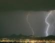 lightning storm over the city lights