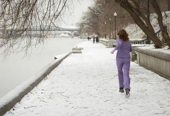 woman jogging at river embankment
