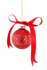 ribbon on red christmas ball hanging over white