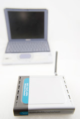 silver laptop and wireless router