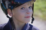 boy wearing a helmet poster