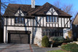 tudor style house with two car garage