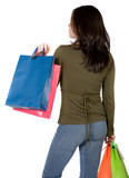 girl with shopping bags from behind poster