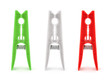 isolated red white and green pegs