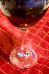 wine glass on red christmas tablecloth