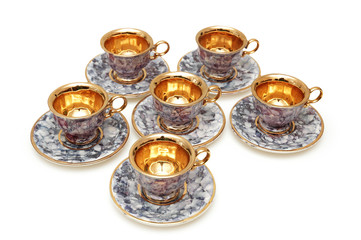 six cups and saucers isolated on white