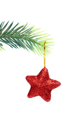 star hanging from christmas tree
