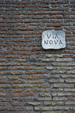 ancient roman wall with street nameboard poster