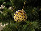 yellow ball on the christmas fir poster