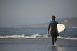 surfer enter in the sea