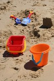 buckets and spades on beach poster