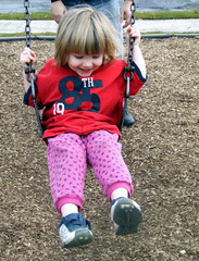 smiling baby on swing