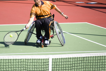 wheel chair tennis for disabled persons (men)