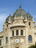 building with clock and domes poster