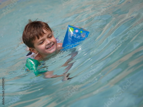 young boy swiming