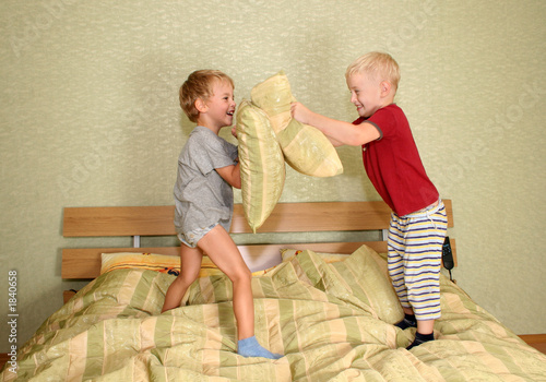children play with pillows