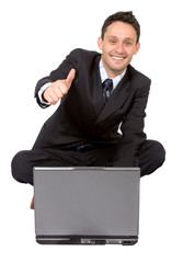 business man on laptop with thumbs up