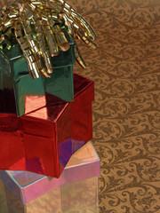 three gifts: stacked star boxes with curly ribbon