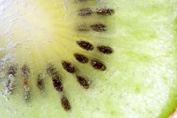 slice kiwi inside ice, macro, background
