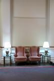 two easy chairs in lobby with high ceiling poster