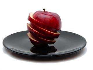 sliced apple on black plate too