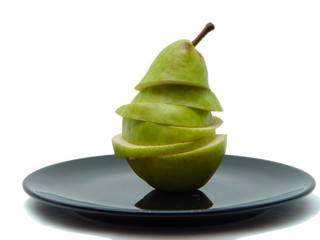 sliced pear on black plate
