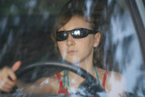 girl driving in car. poster