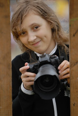 girl with camera in hands.
