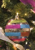 multicolored striped ball ornament poster