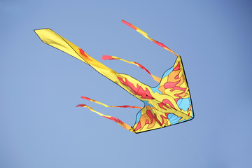 a colorful kite in a deep blue sky